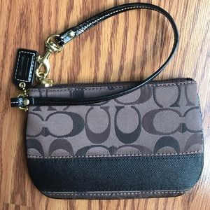 Brown and black COACH wristlet